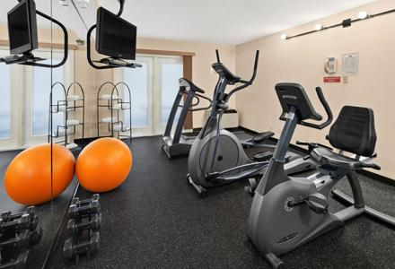 On-site fitness room provides 24-hour access to three cardio machines and basic exercise equipment.