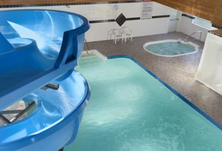Golden hotel with indoor saltwater pool, waterslide and hot-tub, open daily from 6:00am - 10:00pm.